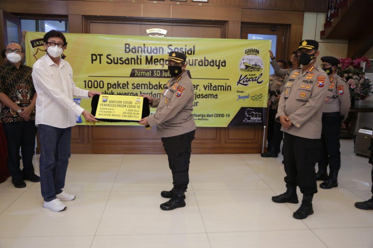 Polda Jatim Terima Bansos PT. Susanti Megah Surabaya, Siap Salurkan | Memo Surabaya